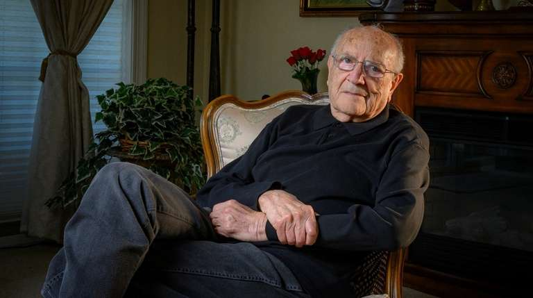 Arnold Fishler, 90, at his Melvillle home Tuesday.