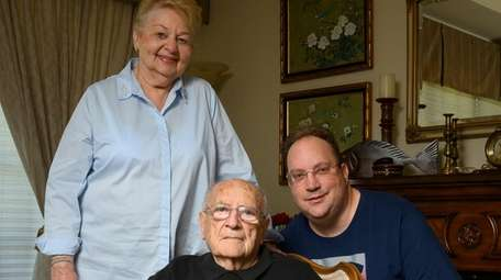 Arnold Fishler, 90, with his wife Beverly and