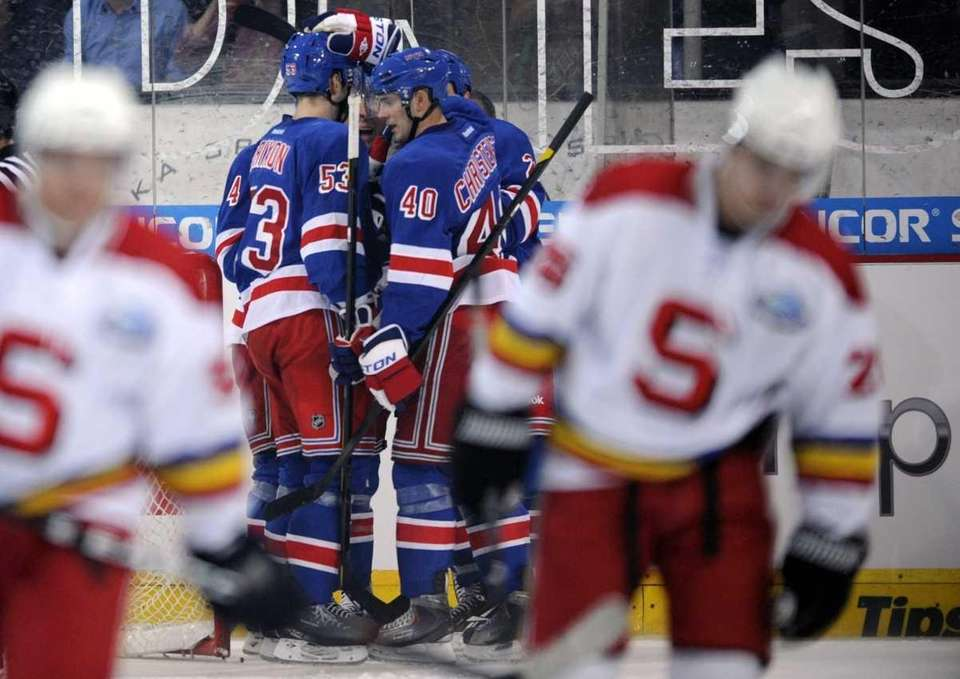 New York Rangers players, center, celebrate their second