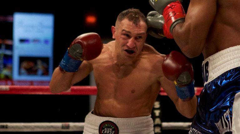 Cletus Seldin of Shirley fights Zab Judah of