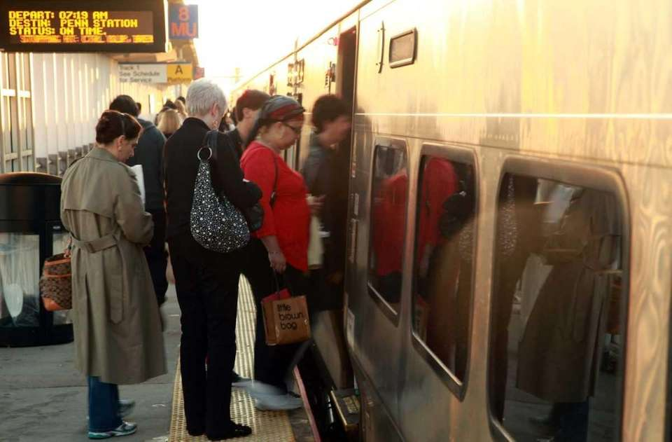 Passengers board a LIRR train at the Ronkonkoma