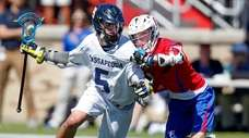 Massapequa's Thomas Greenblatt has pressure from Fairport's Caleb