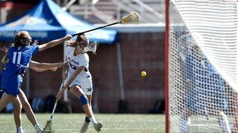 Mattituck/Southold's Mackenzie Hoeg scores on Bronxville goalie Caitlin