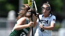 Eastport-South Manor's Olivia Arntsen, right, defends against Fayetteville-Manlius'
