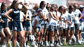 Eastport-South Manor's Jaime Biskup, left, watches from the