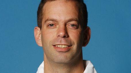 Assistant coach Jim Sann of the Raptors poses