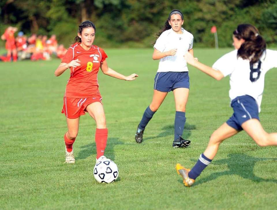 Sacred Heart's #8 Mauve Quinn (wearing red) engages