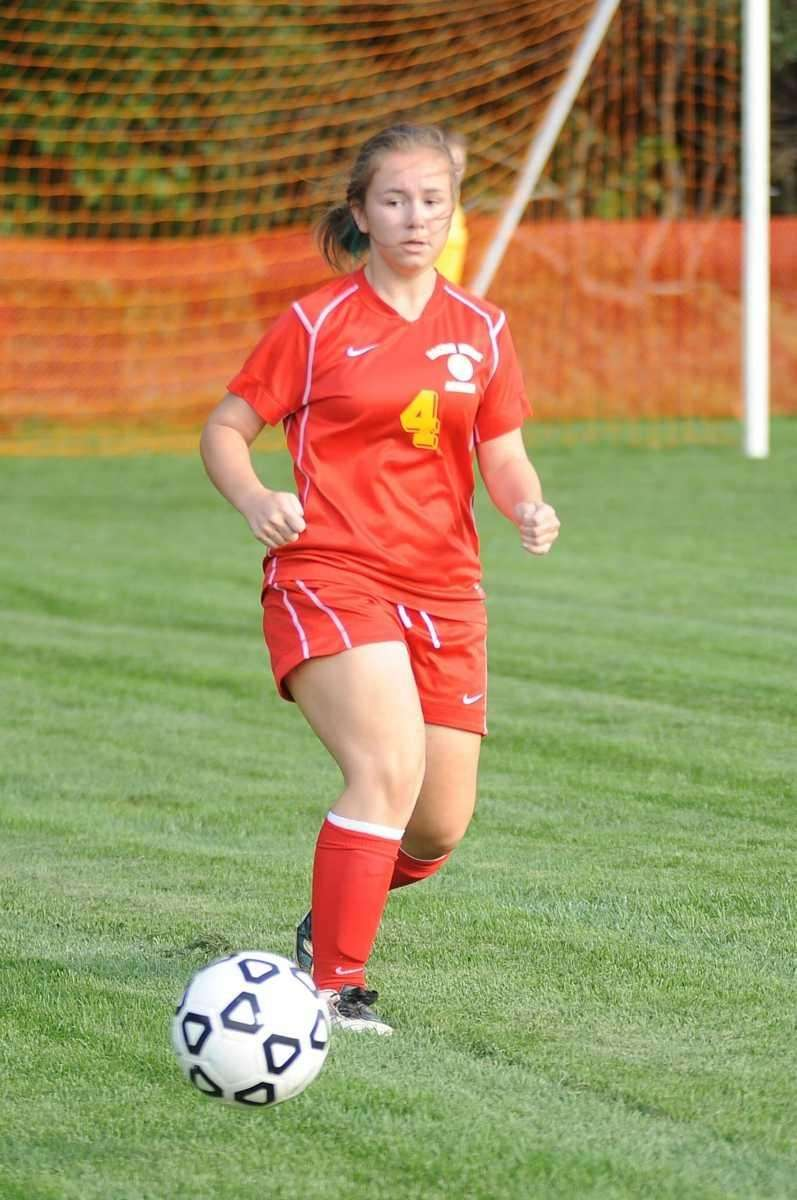 Sacred Heart's #4 Michele Torres dribbles downfield. (Sept.