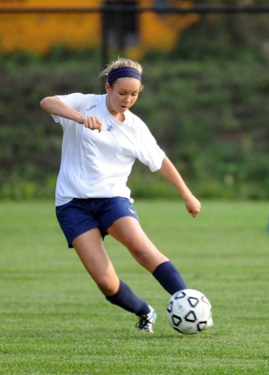 St. Dominic's Mimi Grassi dribbles upfield during a