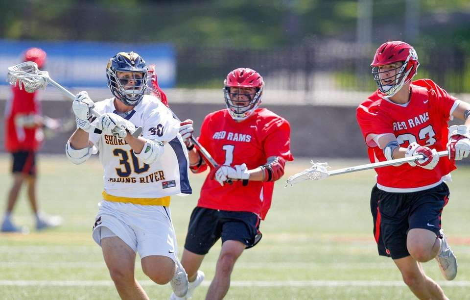 Shoreham-Wading River's Jack Erb gets past Jamesville-DeWitt's Johnny