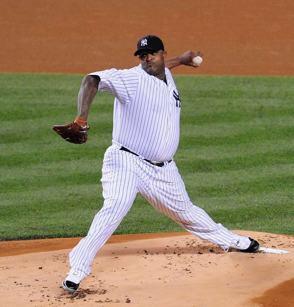 New York Yankees pitcher CC Sabathia throws during