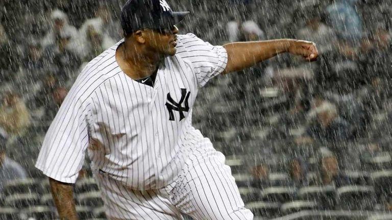 New York Yankees' CC Sabathia #52 pitches to