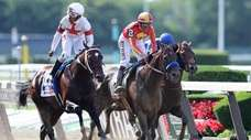 Mitole and jockey Ricardo Santana Jr., left, hold