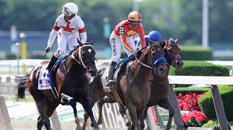 Mitole and jockey Ricardo Santana Jr., left, hold