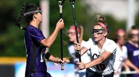 Cold Spring Harbor's Kelly Hooks, right, defends against