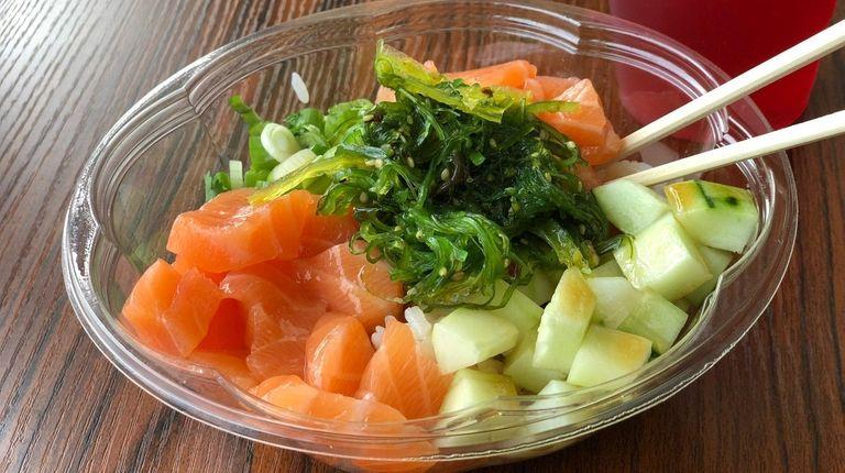 A poke bowl topped with plenty of salmon