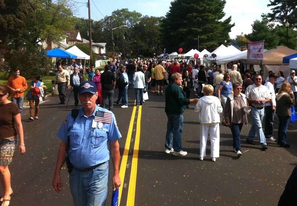 Long Island Fall Festival attendees gather on Madison