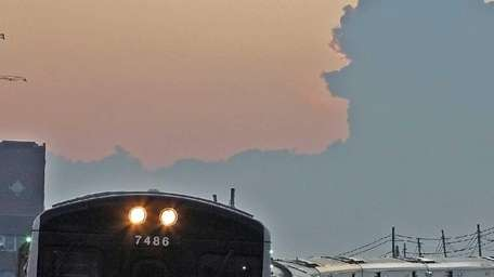 Eastbound LIRR train enters Jamaica station with storm