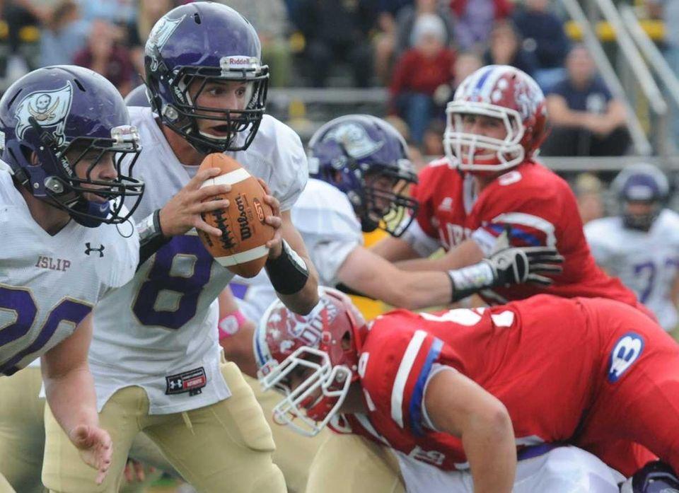 Islip quarterback Joe Sabbatino looking for a receiver.
