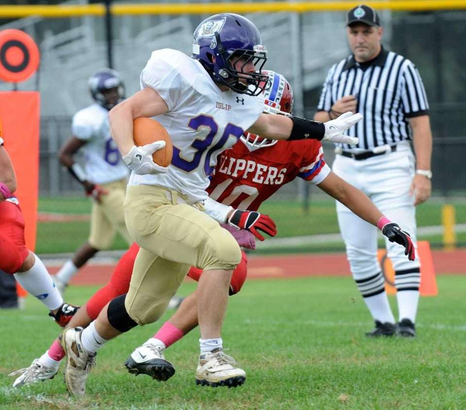 Islip's Johnny Maher breaking free from Bellport's Kevin