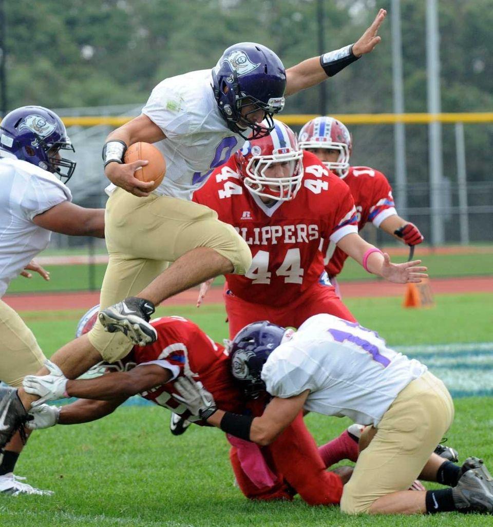 Islip quarterback Joe Sabbatino breaks a tackle. (Oct.