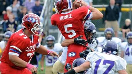 Bellport's Justin Honce is tackled by Islip defenders.