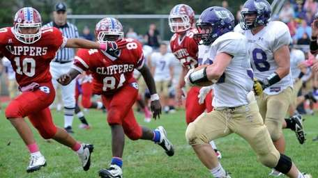 Islip's Johnny Maher with Bellport's Kevin Wilson and
