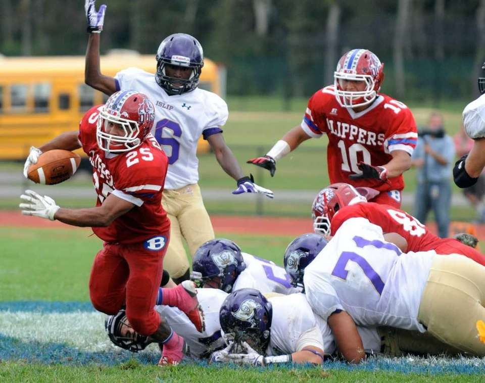 Bellport Eddie Carson breaking tackles during the second
