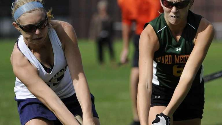 Ward Melville midfielder Kim Geiger, right, and Northport's