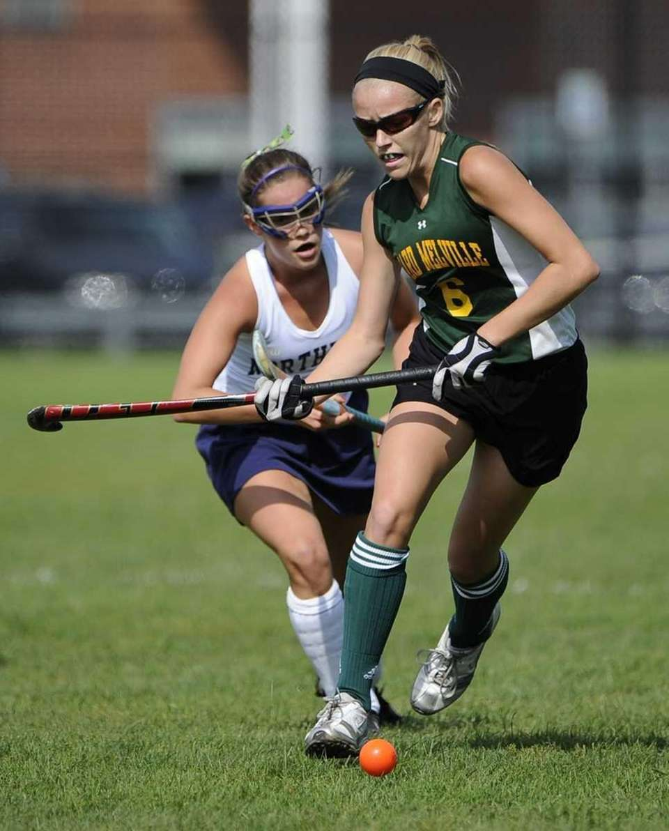 Ward Melville midfielder Kim Geiger goes for the
