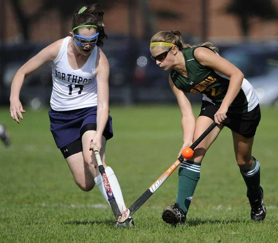 Ward Melville forward Liz Conley, right, and Northport