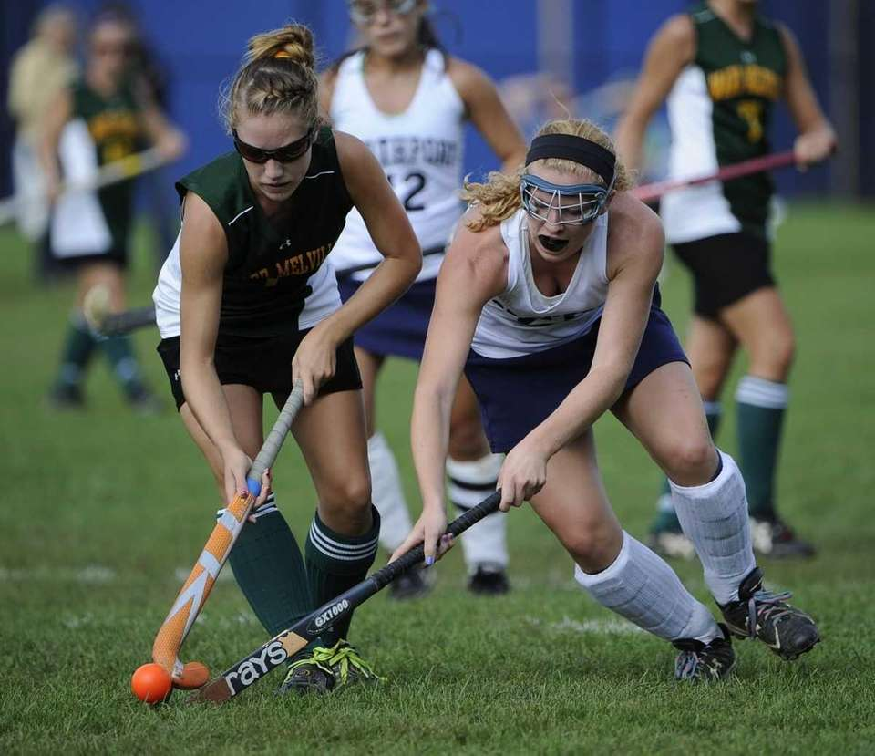 Ward Melville forward Kelsey Catalano, left, and Northport's