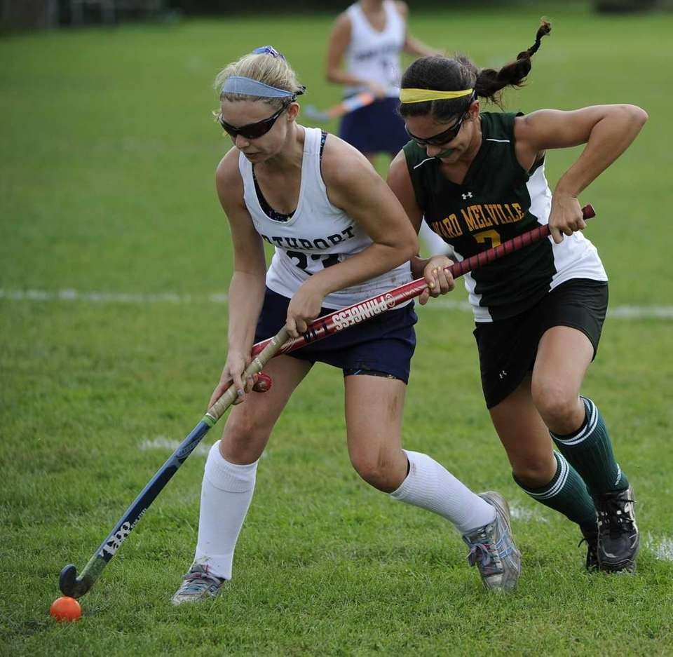 Ward Melville midfielder Vanessa Pryor, right, and Northport