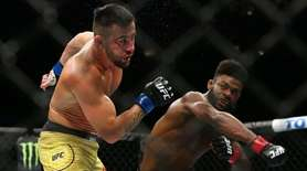 Aljamain Sterling punches Pedro Munhoz during UFC 238