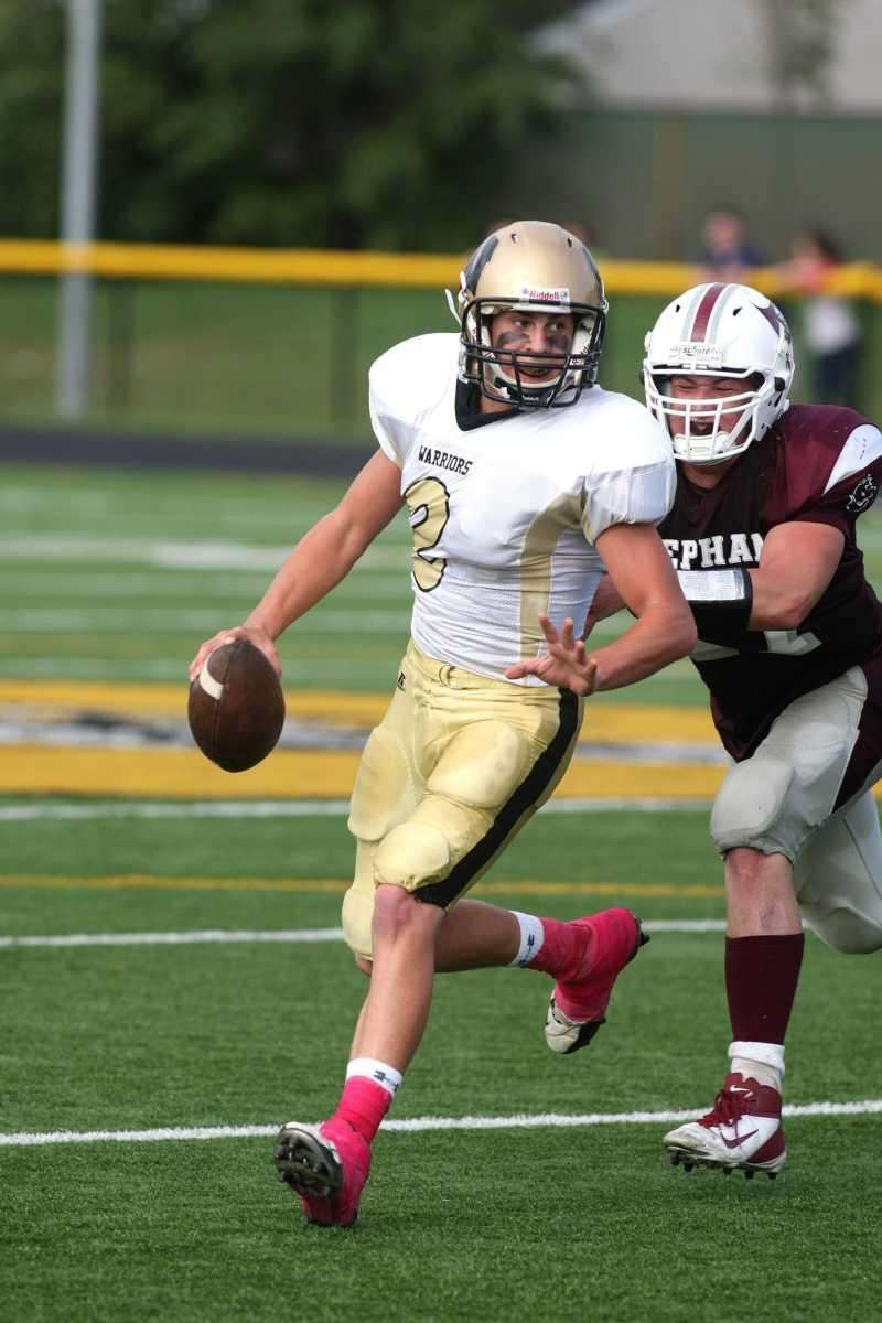 Wantagh H.S. quarterback Nick Mullen, no. 2, being