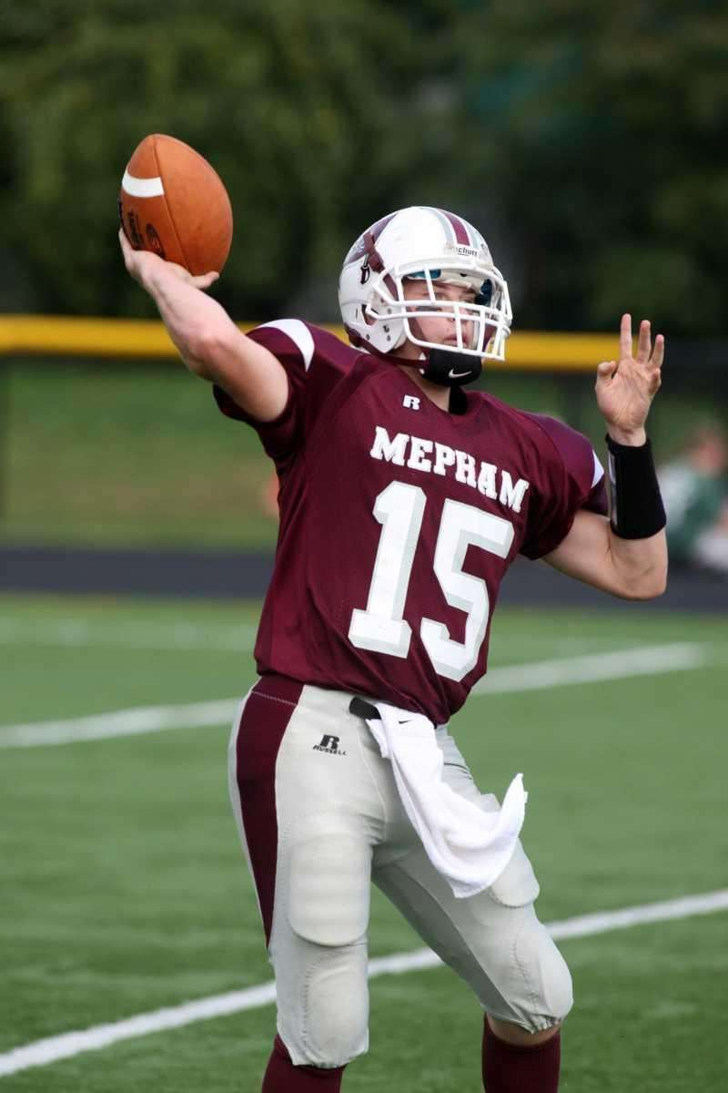 Mepham H.S. quarterback AJ Heller, no. 15, in