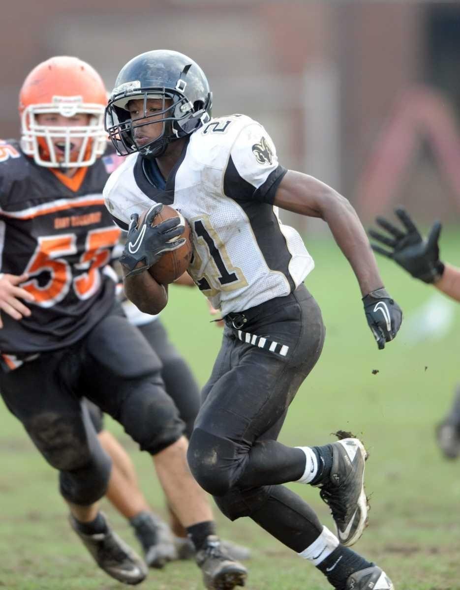 West Hempstead's #21 Tayvon Hall carries for yardage