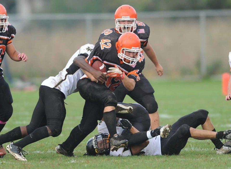West Hempstead defenders try to bring down East