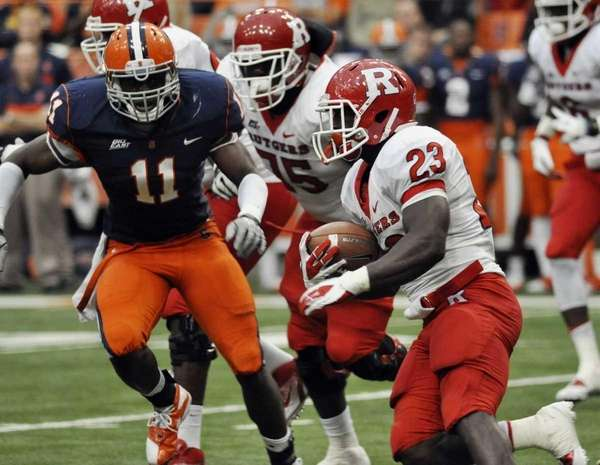 Rutgers' Jawan Jamison runs carries the ball agianst