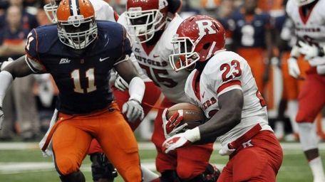 Rutgers' Jawan Jamison runs carries the ball agianst