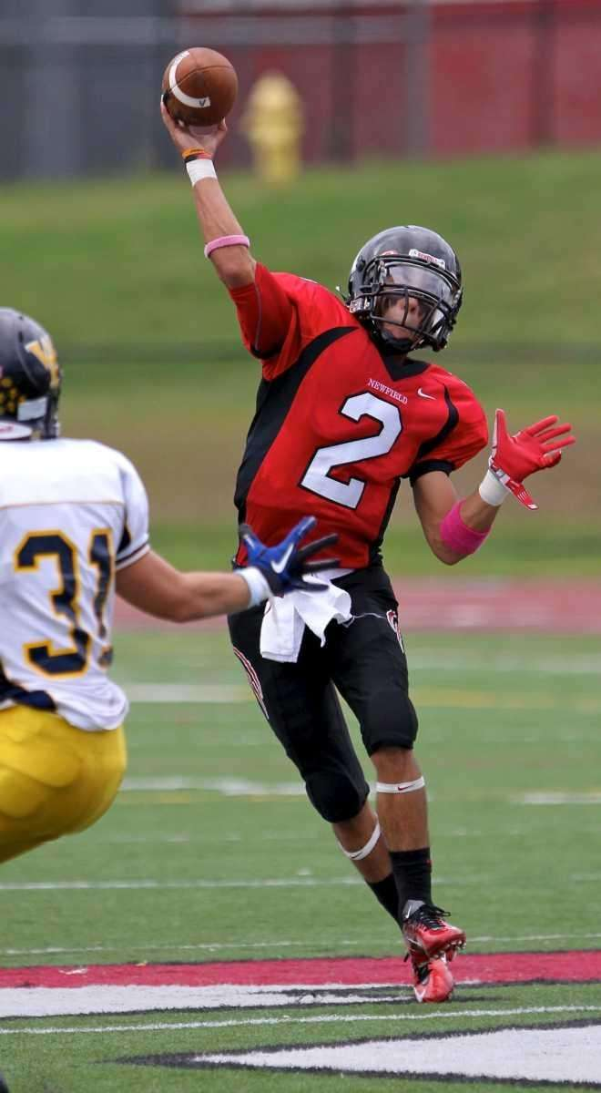 Newfield quarterback Mike Silva #2, gets the pass