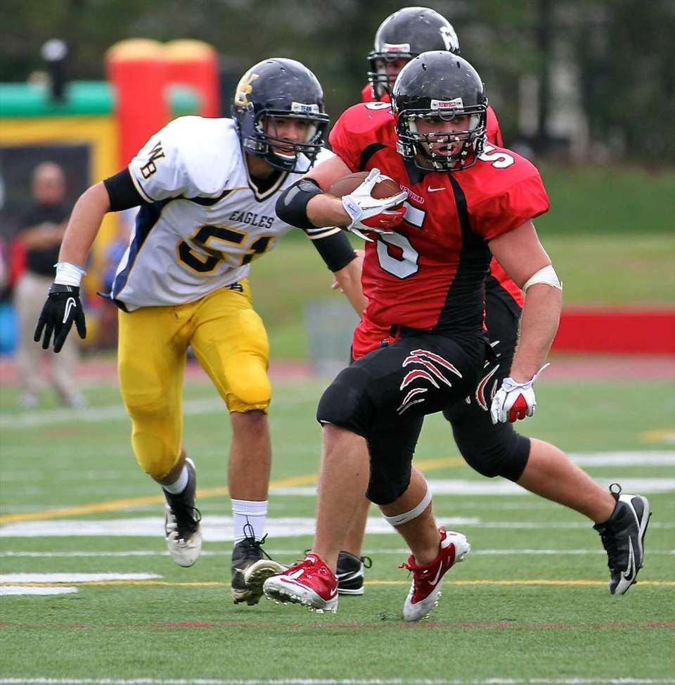 Newfield running back Ron Denig #5 goes to