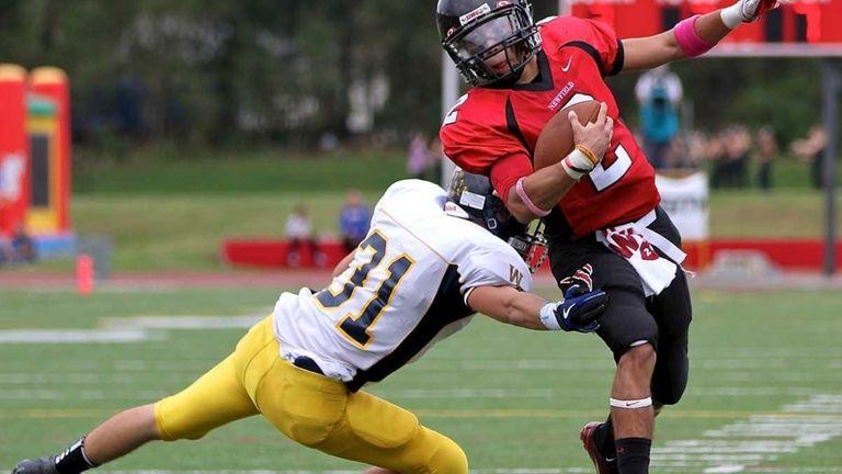 Newfield quarterback Mike Silva #2, side steps the