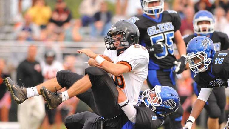 Babylon's Grant Shannon (28, top), gets a hard
