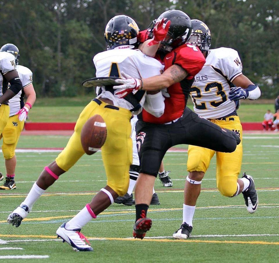 West Babylon defensive back Michael Richardson #4 breaks