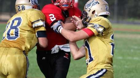 Plainview quarterback Nick Frenger cannot get past Bethpage