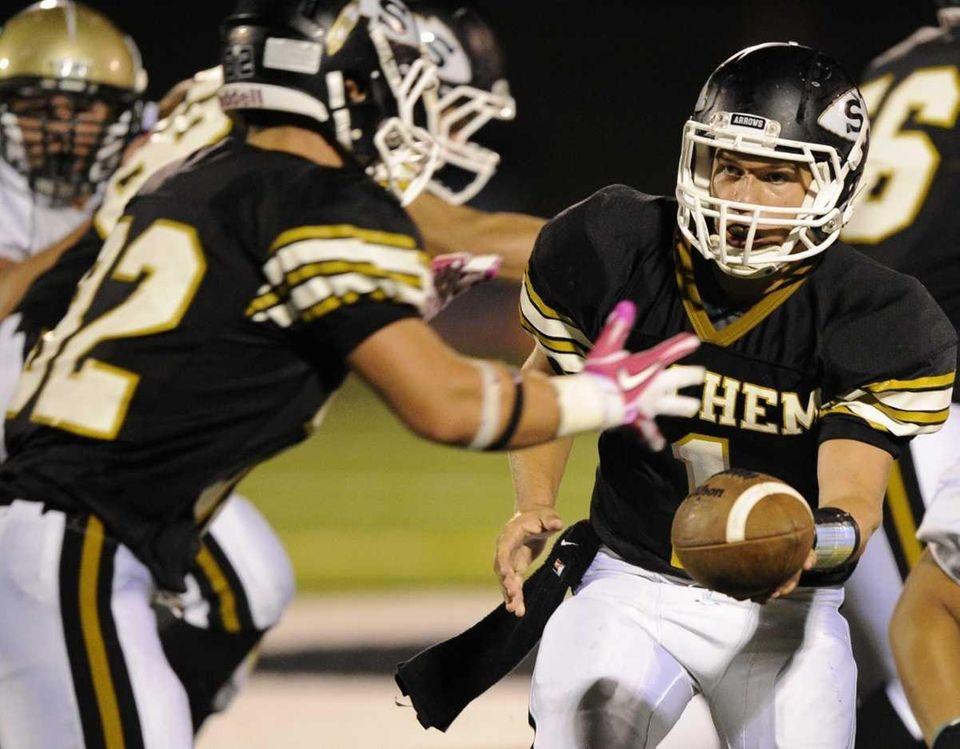 Sachem North quarterback Trent Crossan hands the ball