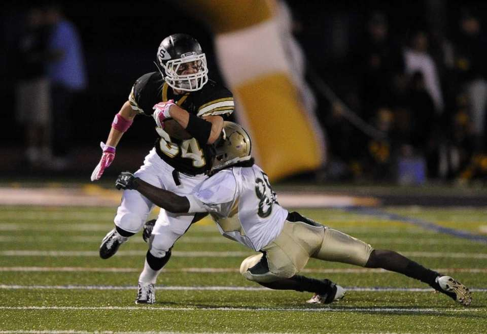 Sachem North's Dalton Crossan is tackled by Longwood's