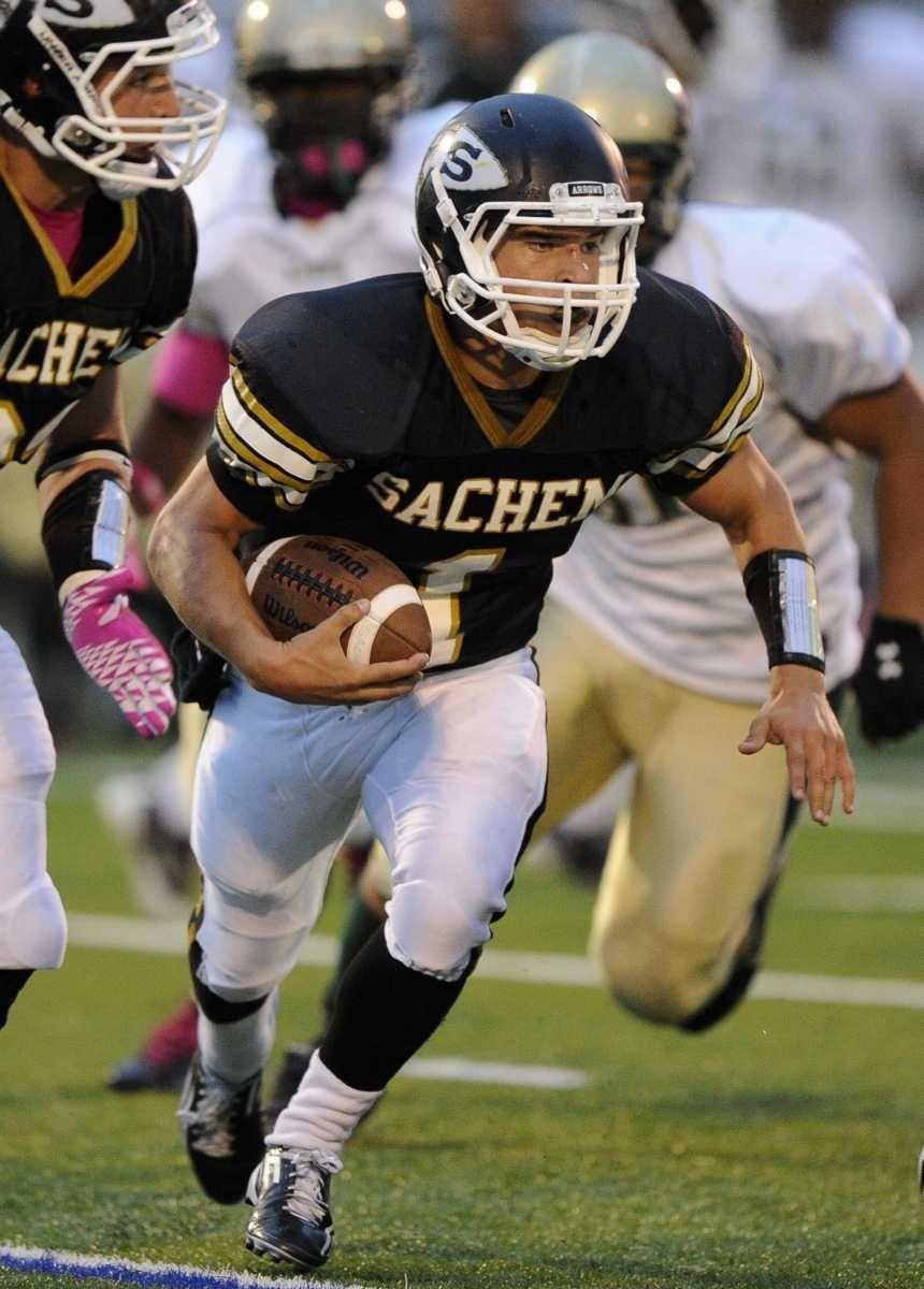 Sachem North quarterback Trent Crossan runs with the