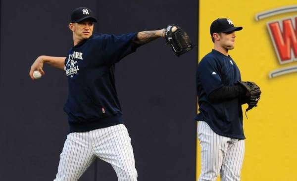 Yankees pitcher AJ Burnett throws during warmups before